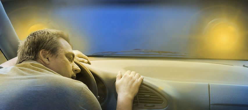 image of man asleep at the wheel