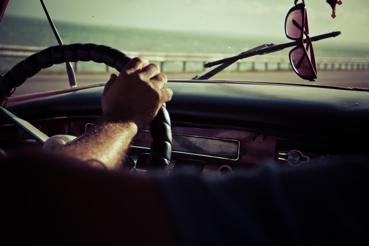 mans hands on wheel driving image