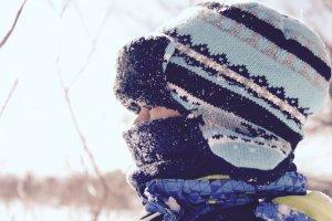 boy in cold attire in snow