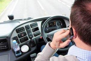 man on phone driving image