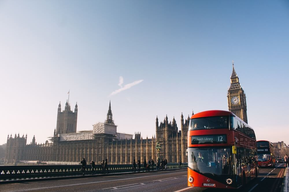 image of double decker bus in london by big ben