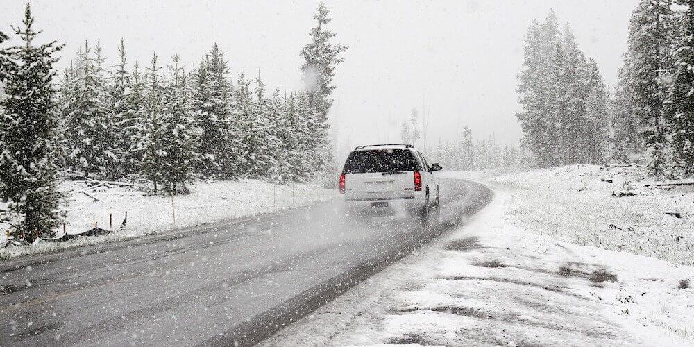 car in white snowy landscape
