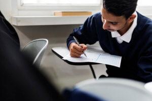 boy taking exam image