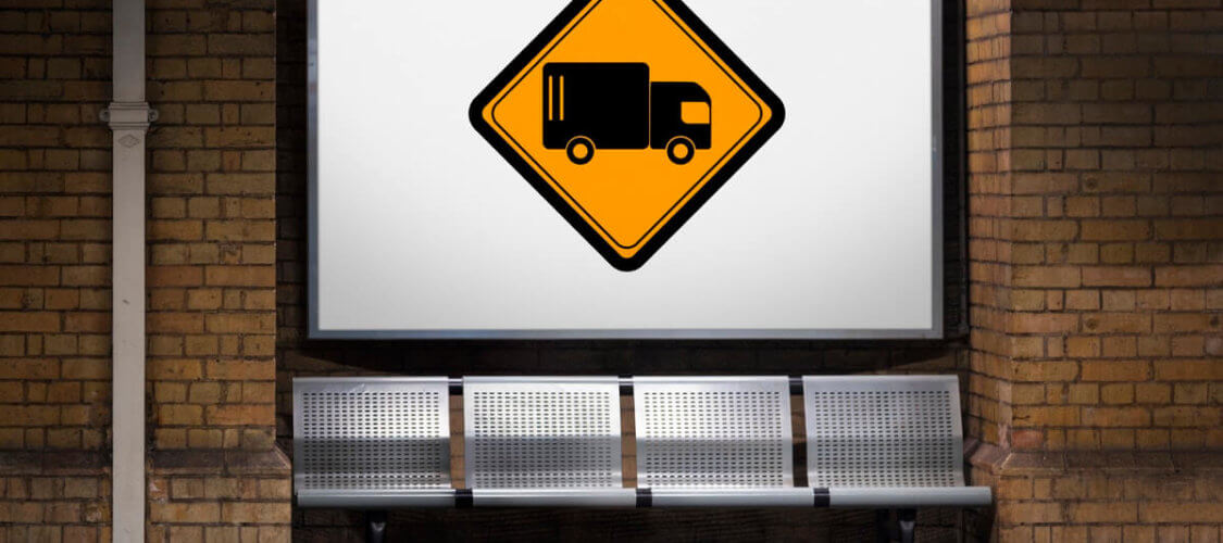 sign displaying a graphic of a lorry