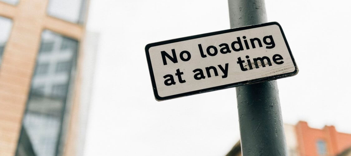 no loading at any time sign
