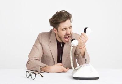 man screaming into phone