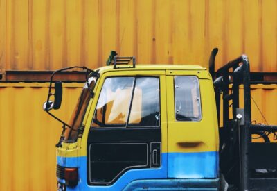 vibrant image of hgv truck in yellow and blue